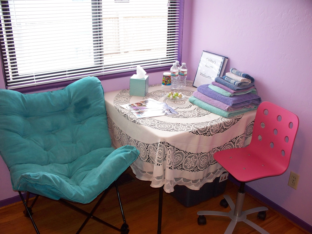 In the window corner of the room is the table (with amenities) and the butterfly chair.