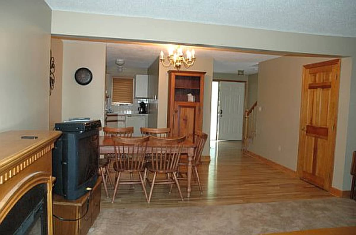 Looking back to kitchen  and front door.  Stairs to basement with washer and dryer.  Full bath on this floor with  tub/shower.