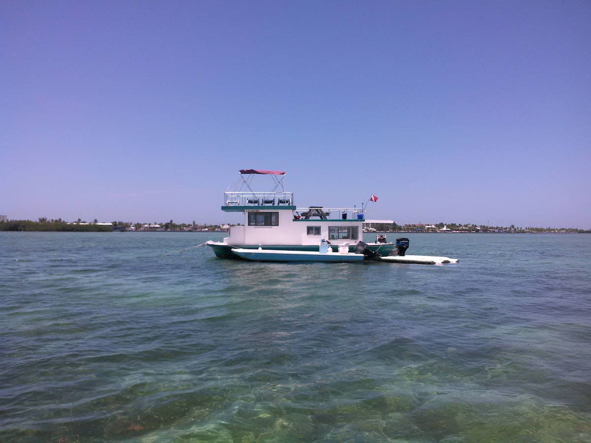 Free Spirit with some improvements.....now with floating deck, jet ski dock, and bimini. New generator.