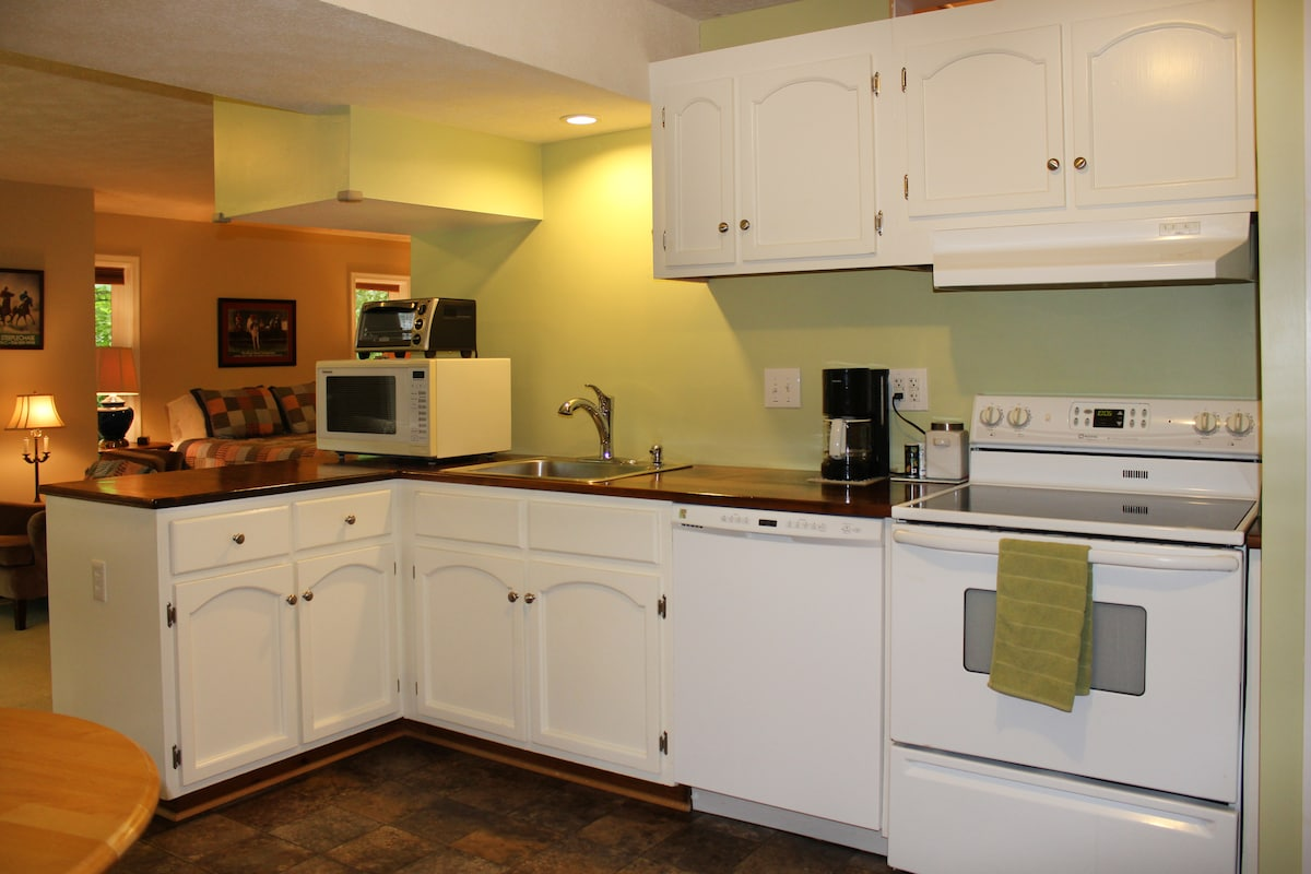 The kitchen has walnut counter tops, stove/oven, refrigerator, dishwasher, microwave, coffee pot, toaster oven, and garbage disposal.  All appliances are full-size.