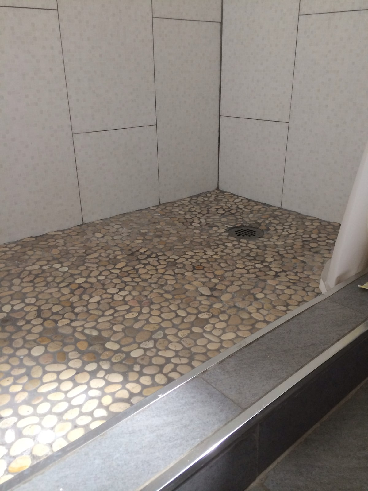 Pebble stone floor tiles for your soothing shower experience.