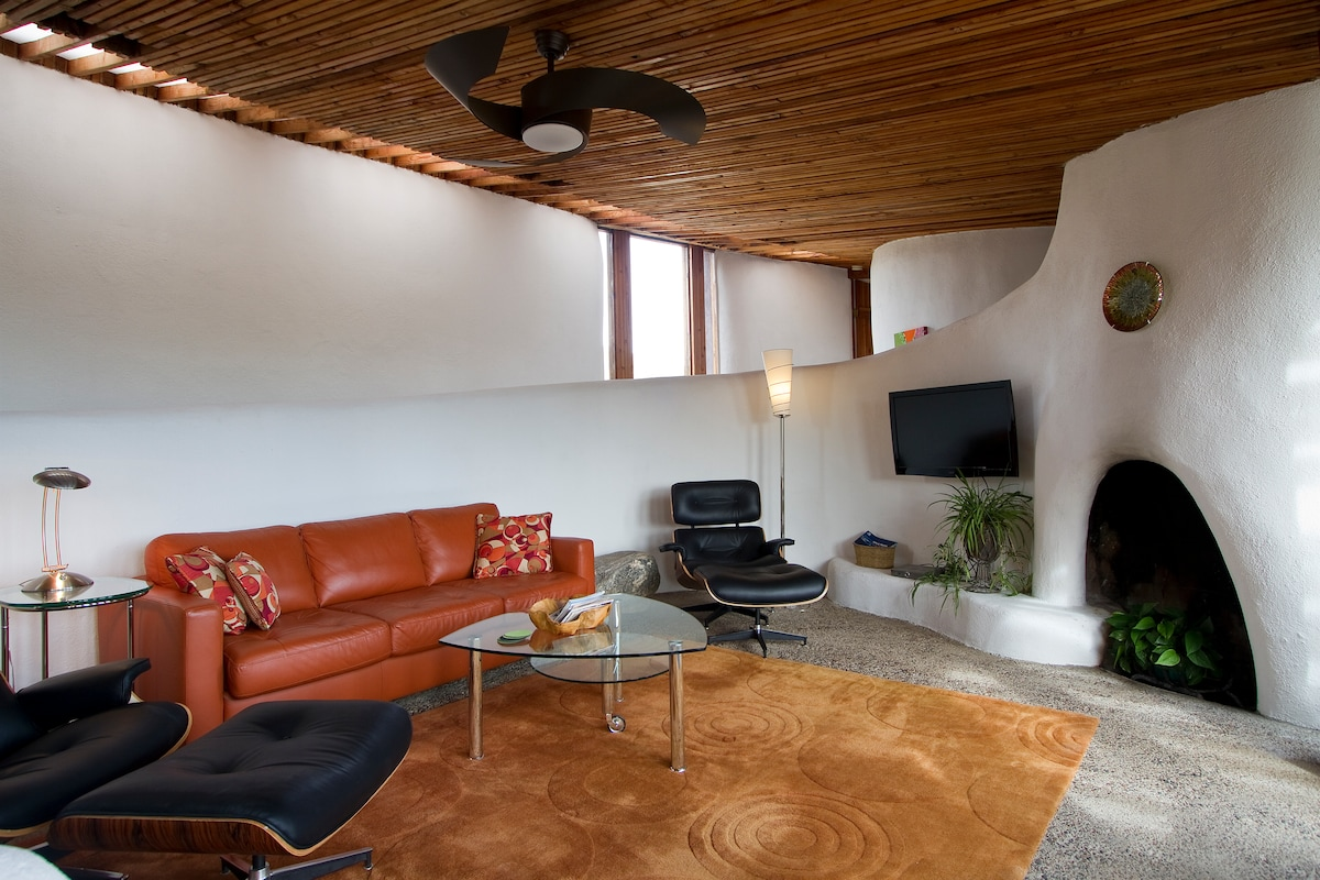 """Living Room with 42"""" TV with Satellite service. Sofa can become a queen size bed for larger parties."""