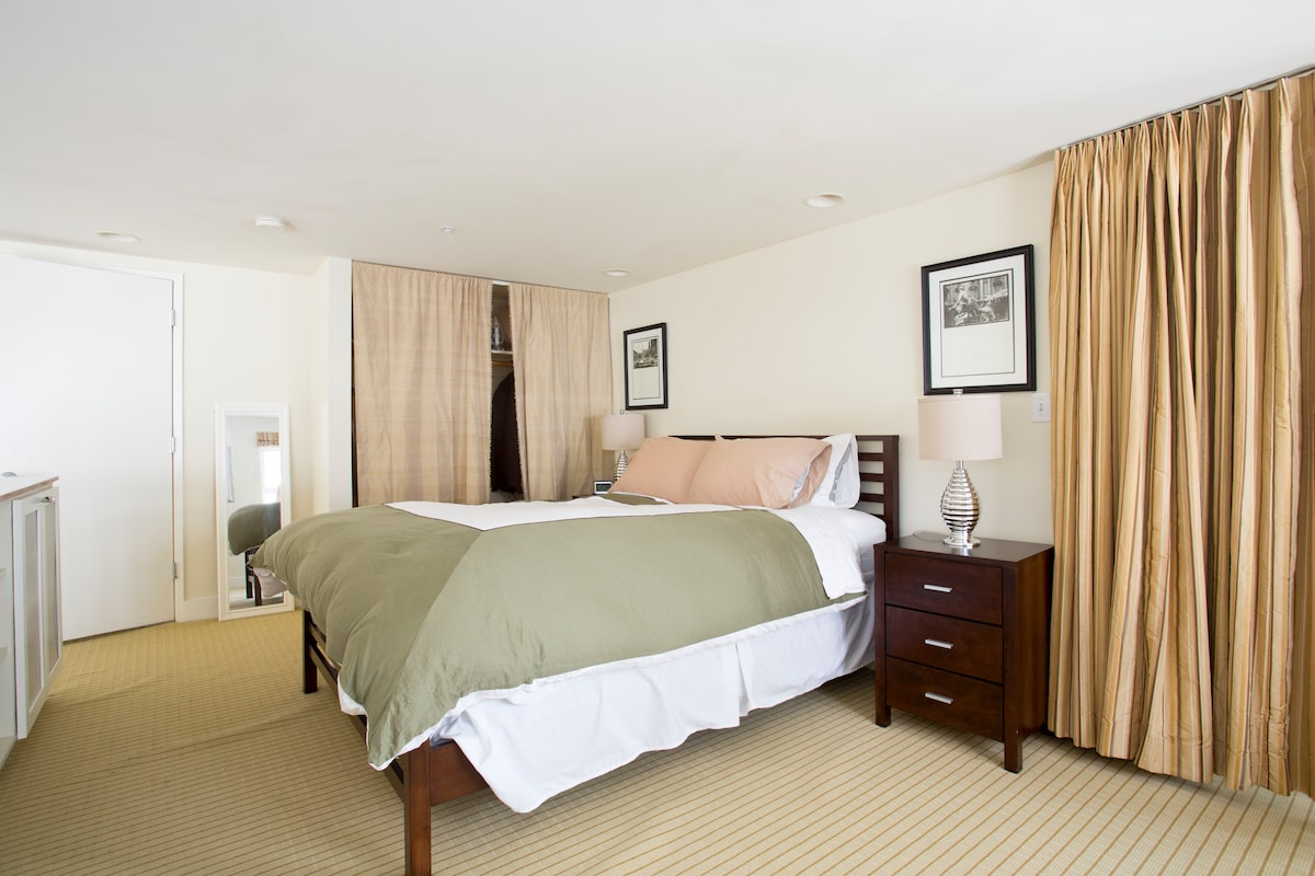 Upper level features a queen sized bed.