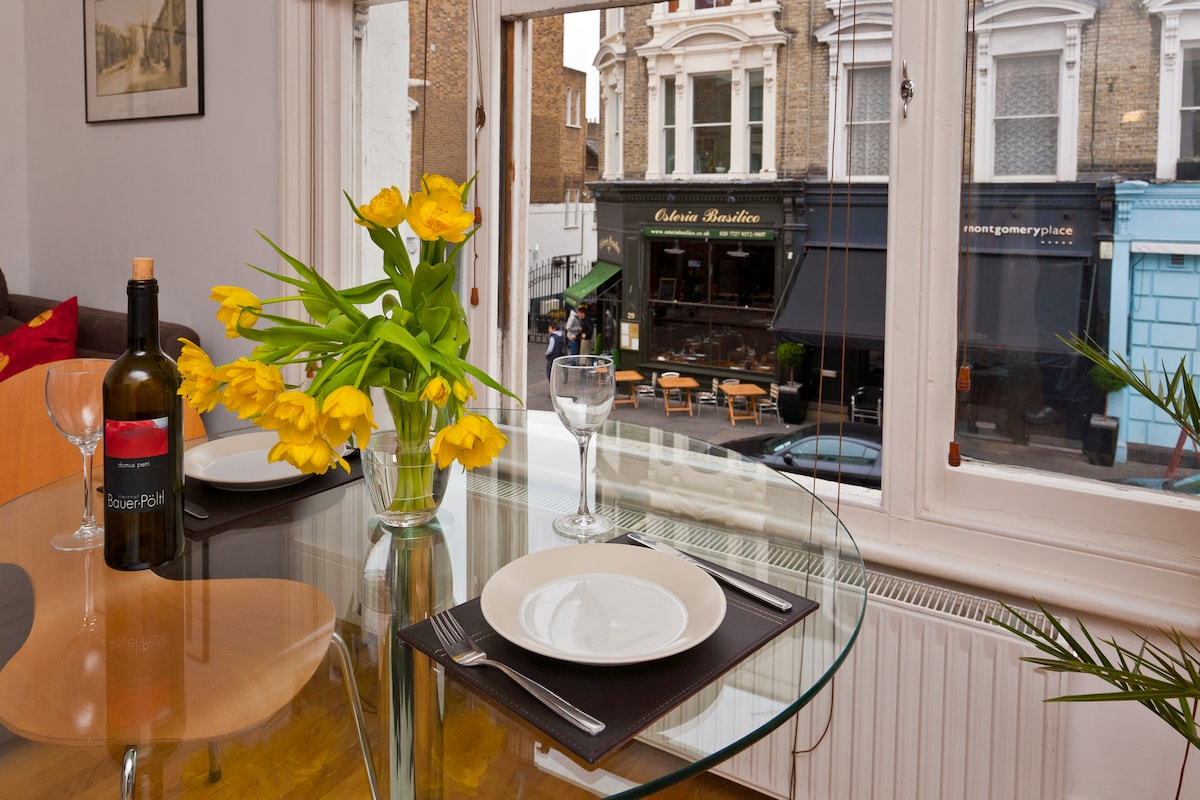 Dine at the huge sash window and watch the world go by outside in this vibrant restaurant area.