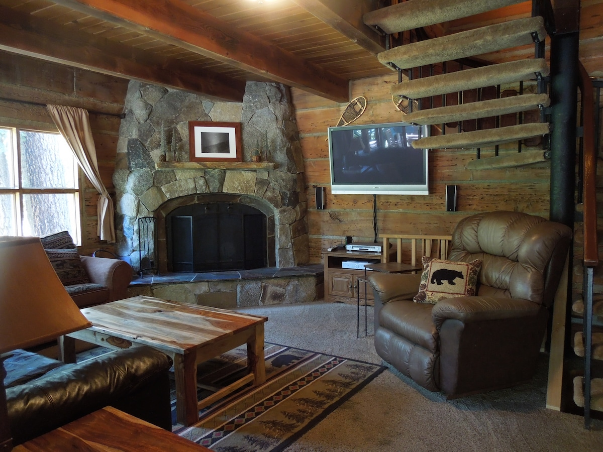 "Living room with huge natural rock fireplace & 50"" TV"