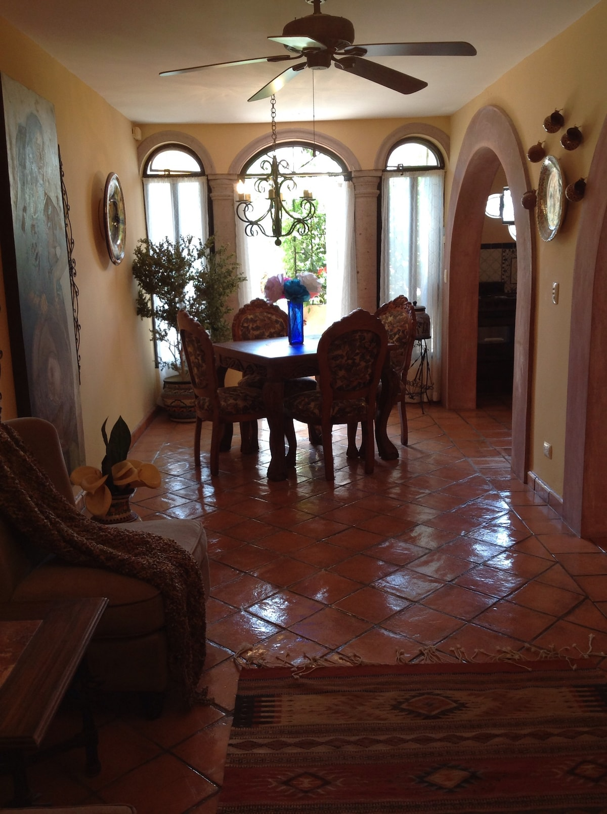 Looking from the fireplace to the dining area; the kitchen is through the arch on the right.