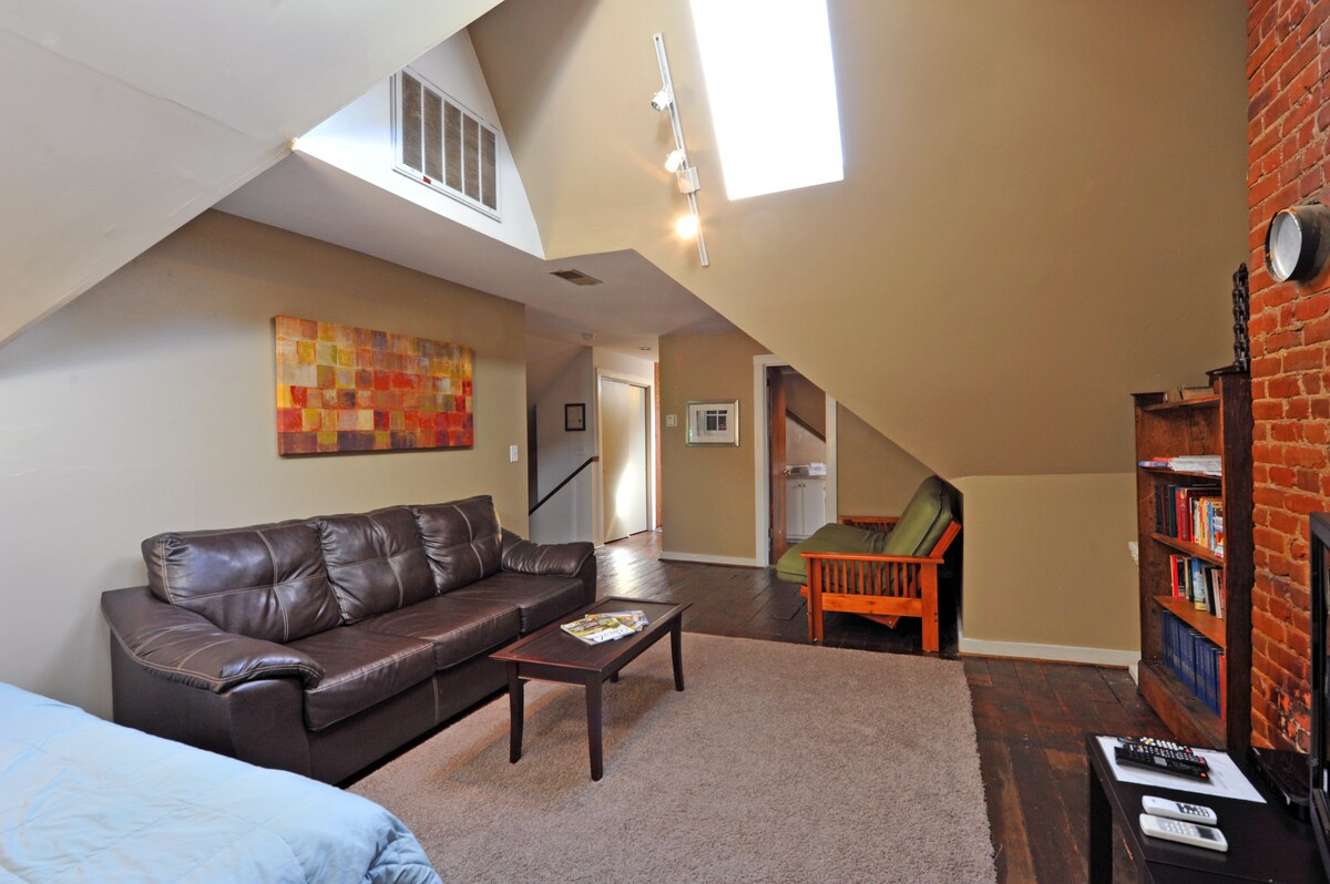 Skylights and vaulted ceilings shape the main living area.