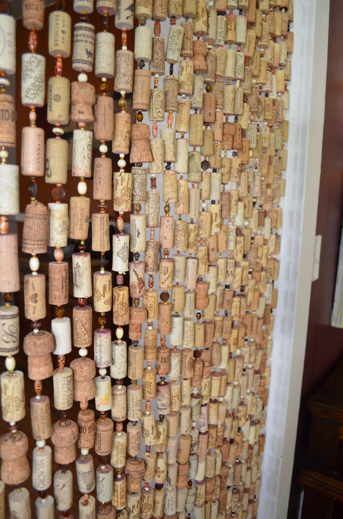A wine cork curtain divides the living room and kitchen.