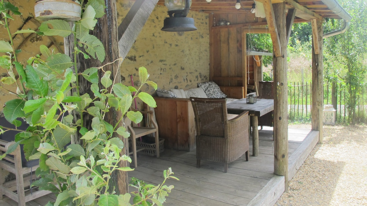 The veranda, the place to relax and chill, hammocks available and plenty of chairs in the garden
