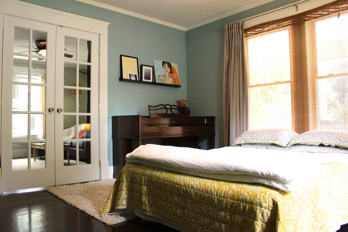 Bright and cheery room! The french doors have curtains to provide privacy.