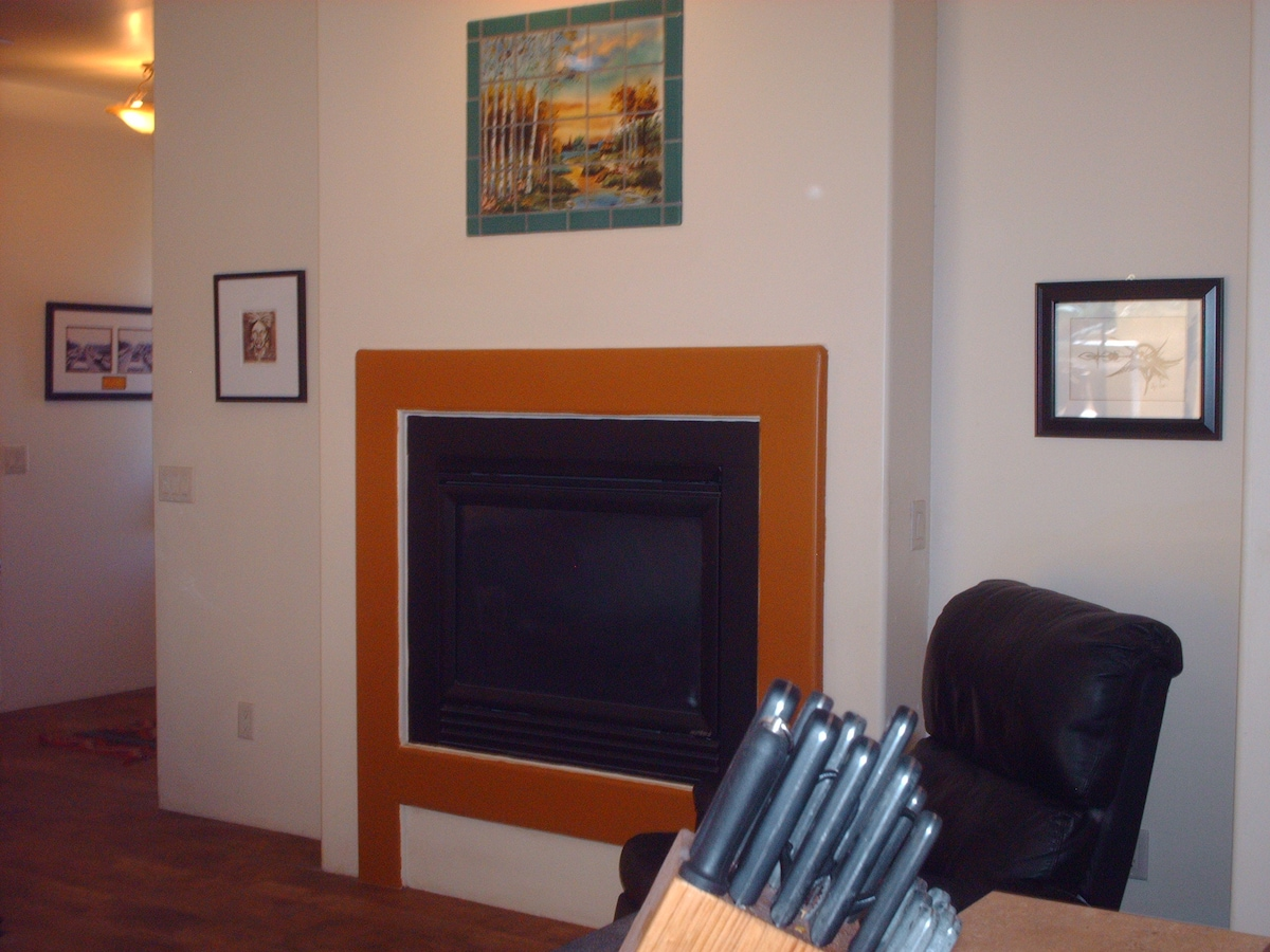 The two room fireplace from the kitchen island