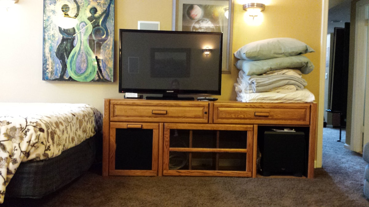 Full cable, surround sound, HD TV in the basement for you to enjoy.  Next to it are extra blankets, etc.