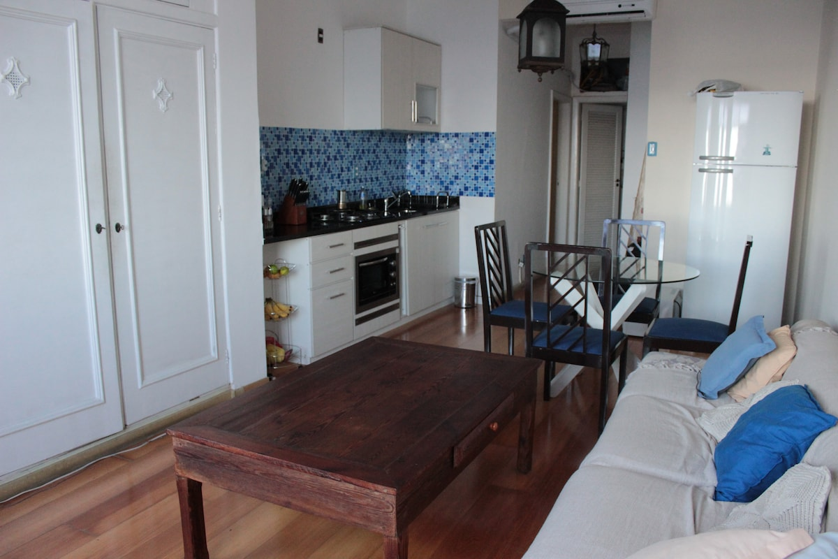 The living room with equipped kitchen to your disposal