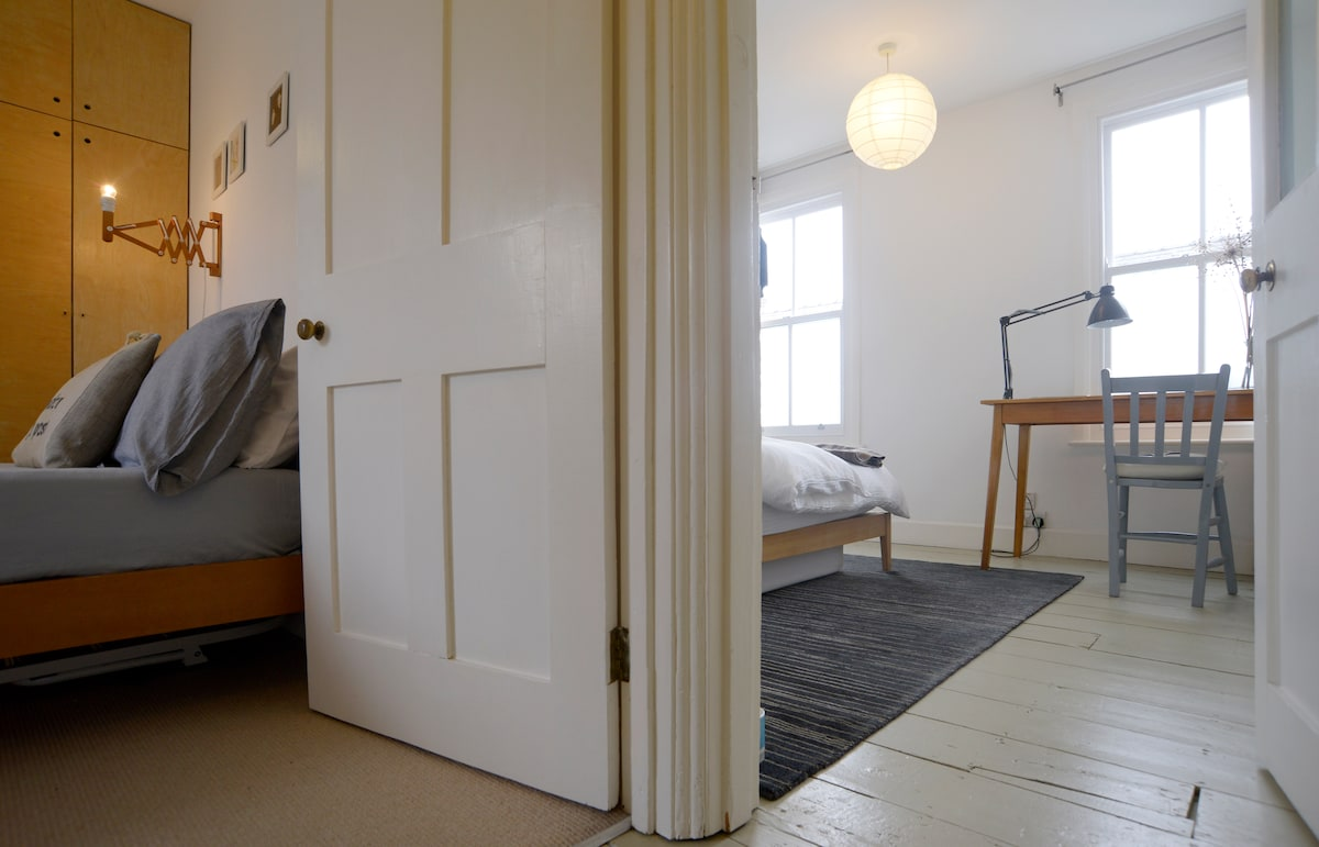 The view of the two bedrooms from the staircase The floor is painted in 'Bone' paint by Farrow & Ball.