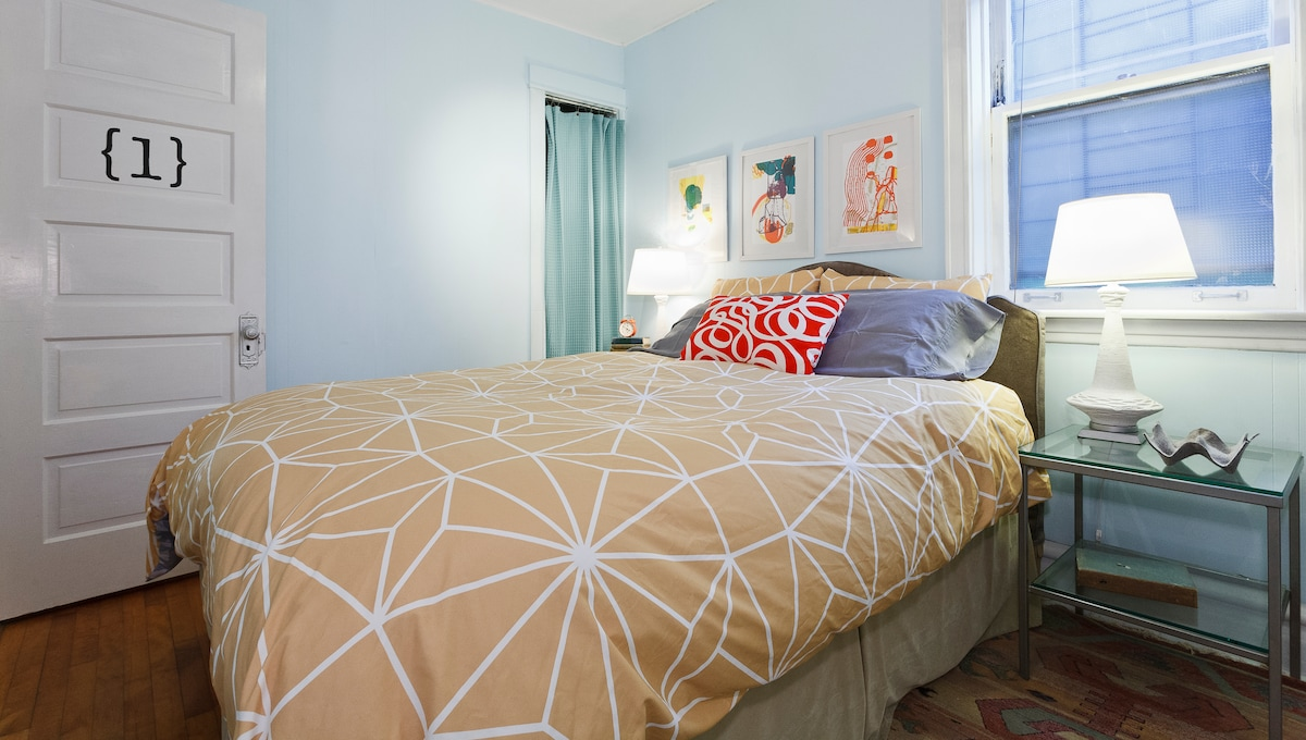 A queen-size bed and good reading lights await in the master bedroom.