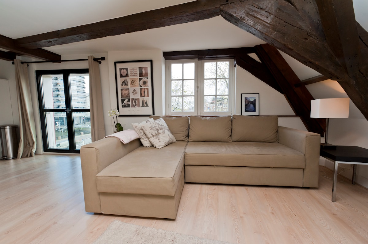 Lounge with authentic details such as the original wooden beams