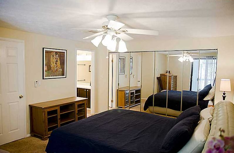 Master bedroom. Comfortable king size bed with leather(like)  headboard. Plenty of closet space. Private large master bathroom.