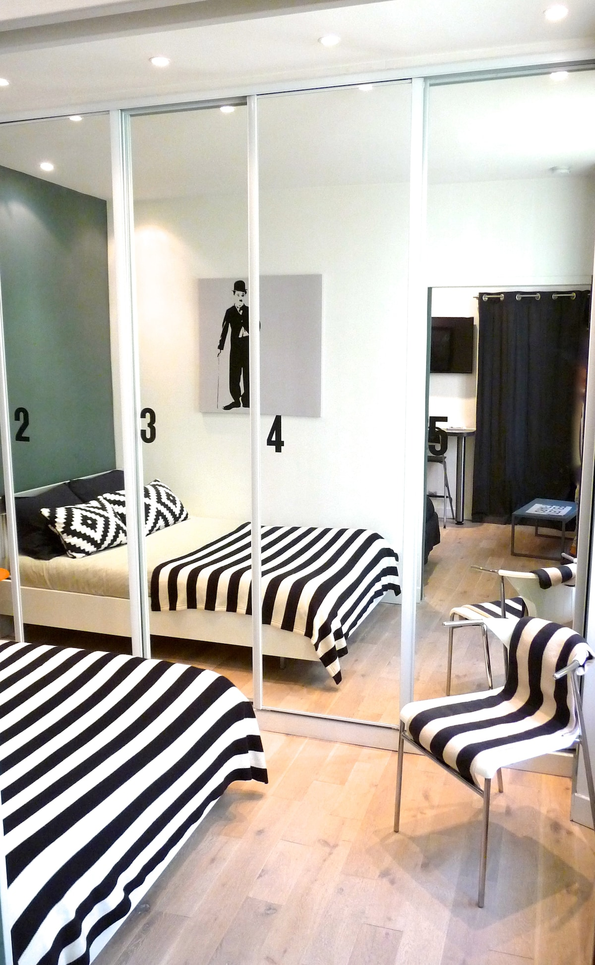 Separated Bedroom with a spacious wardrobe and mirrors.