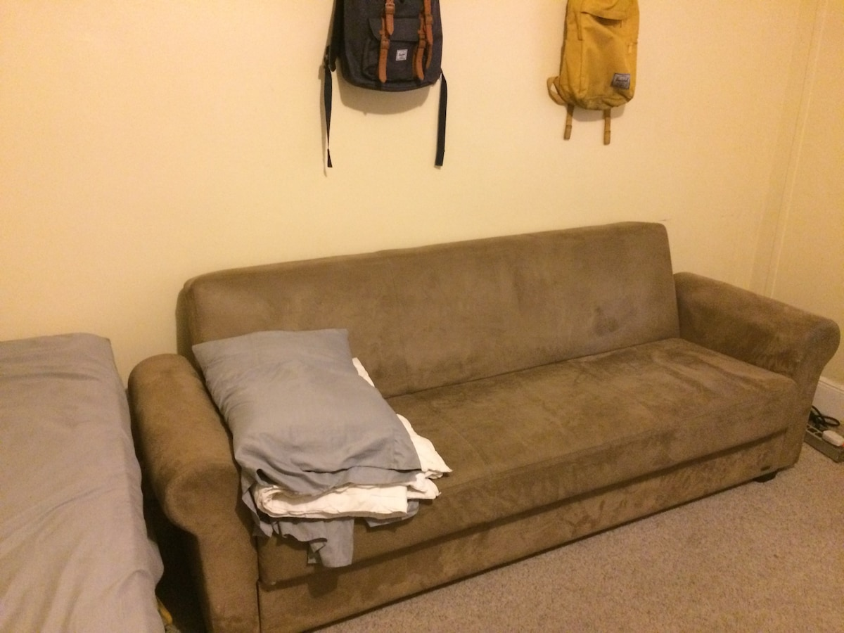 Comfy couch in Queens!