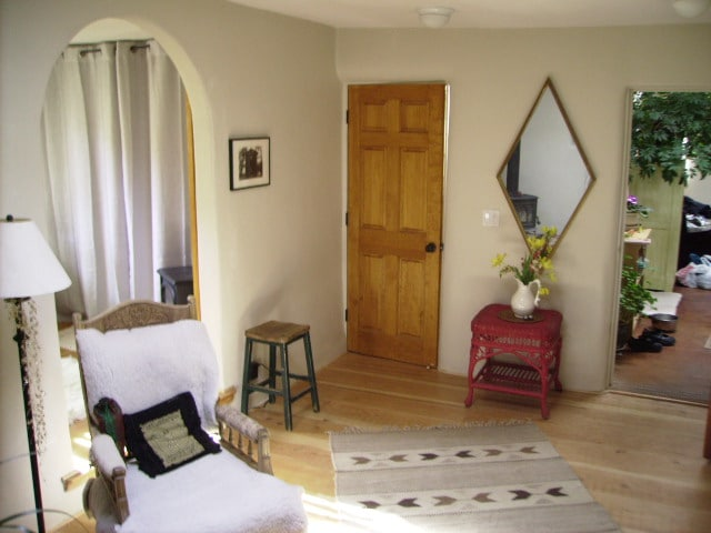 The closed door is your room, off the kiva, which has a cozy wood stove.