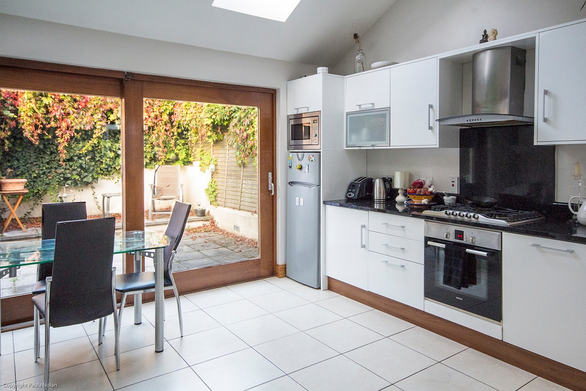 The kitchen is bright and airy, with an outside area where guests are allowed to smoke.