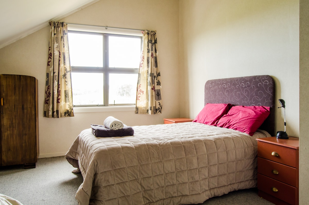 Bedroom 2 - with a double and single bedroom, easy access to bathroom, lookout towards the hills
