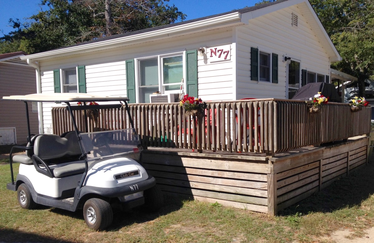 Ocean Lakes cottage #N77. Golf cart is provided with cottage *at no extra cost*.