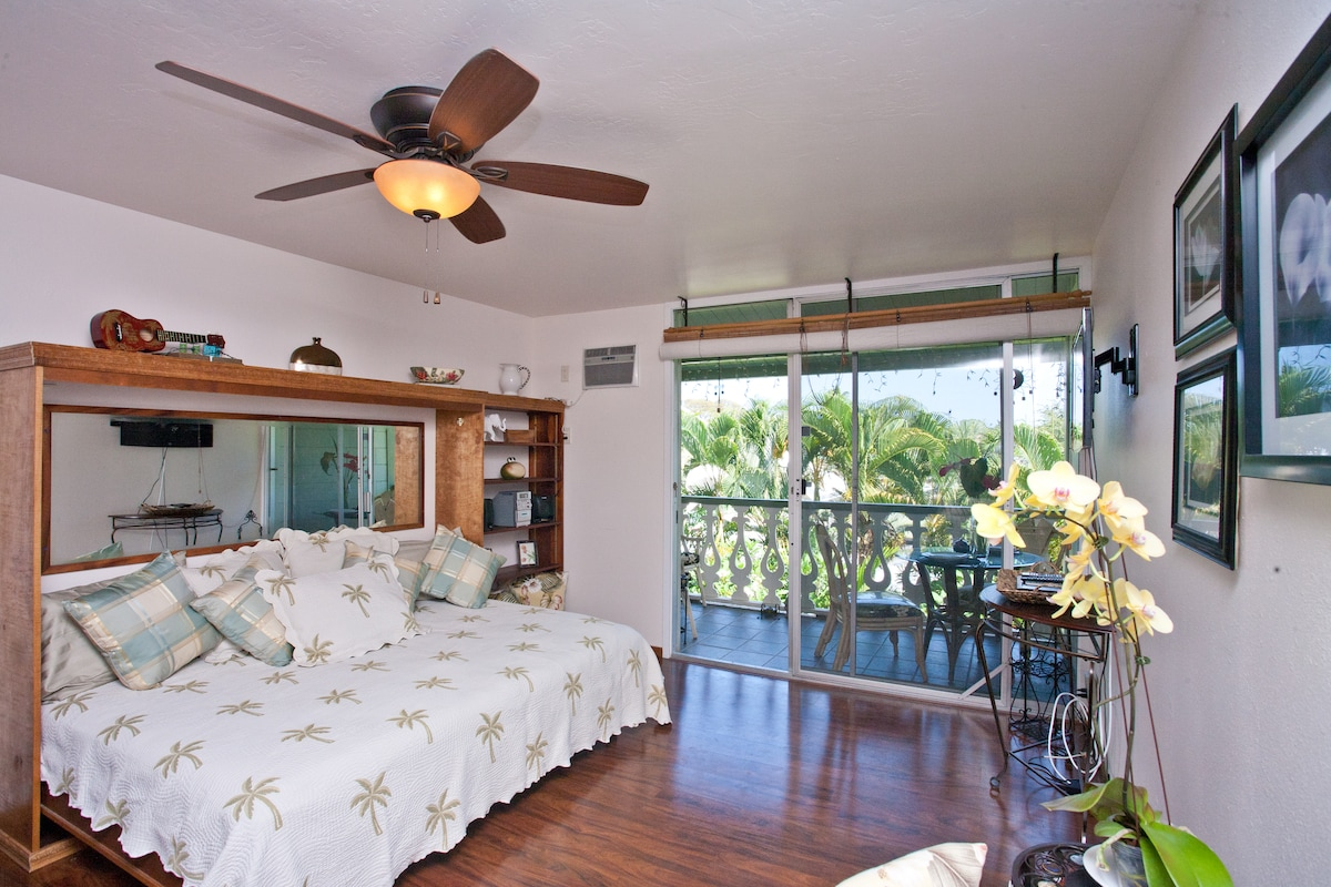 Living area opens to large Lanai overlooking tropical garden!