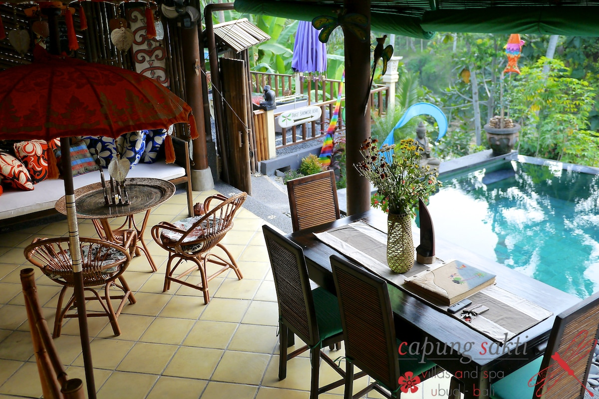 Private terrace, just in front the Swimming pool. Eyes in the green of the rice-fields