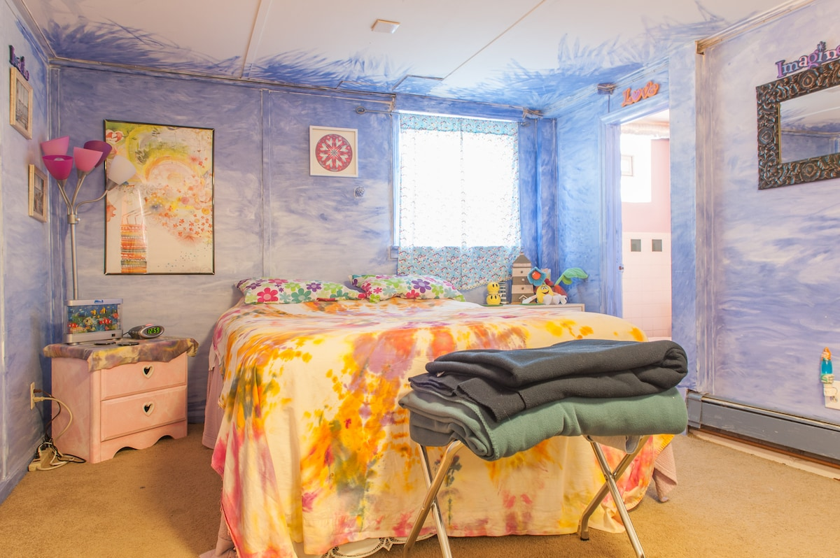 Enjoy a comfortable queen size bed in a groovy setting!