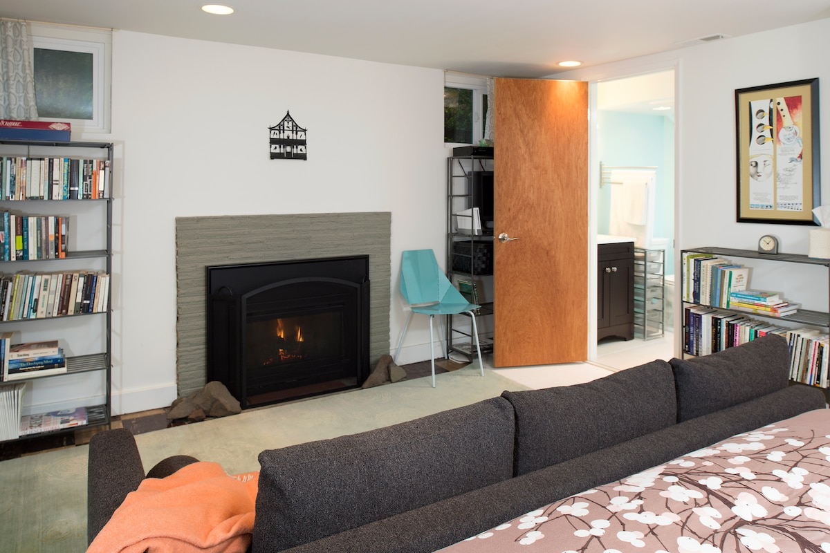 A view of the couch & the fireplace at the foot of the king size bed.