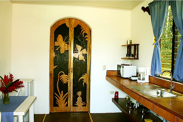 Mariposa kitchen with hand-carved doors