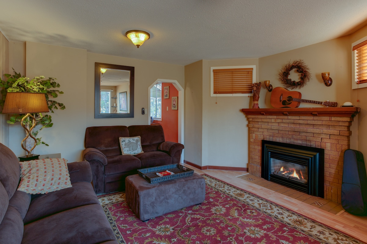 Large living room for relaxing. Gas insert fireplace adds warmth and character.