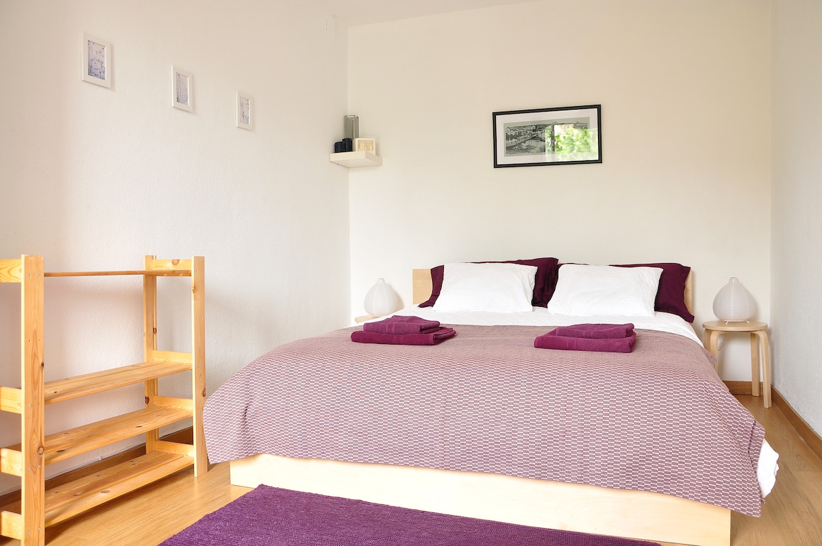Bedroom 1. A large double bed in a spacious room with balcony.