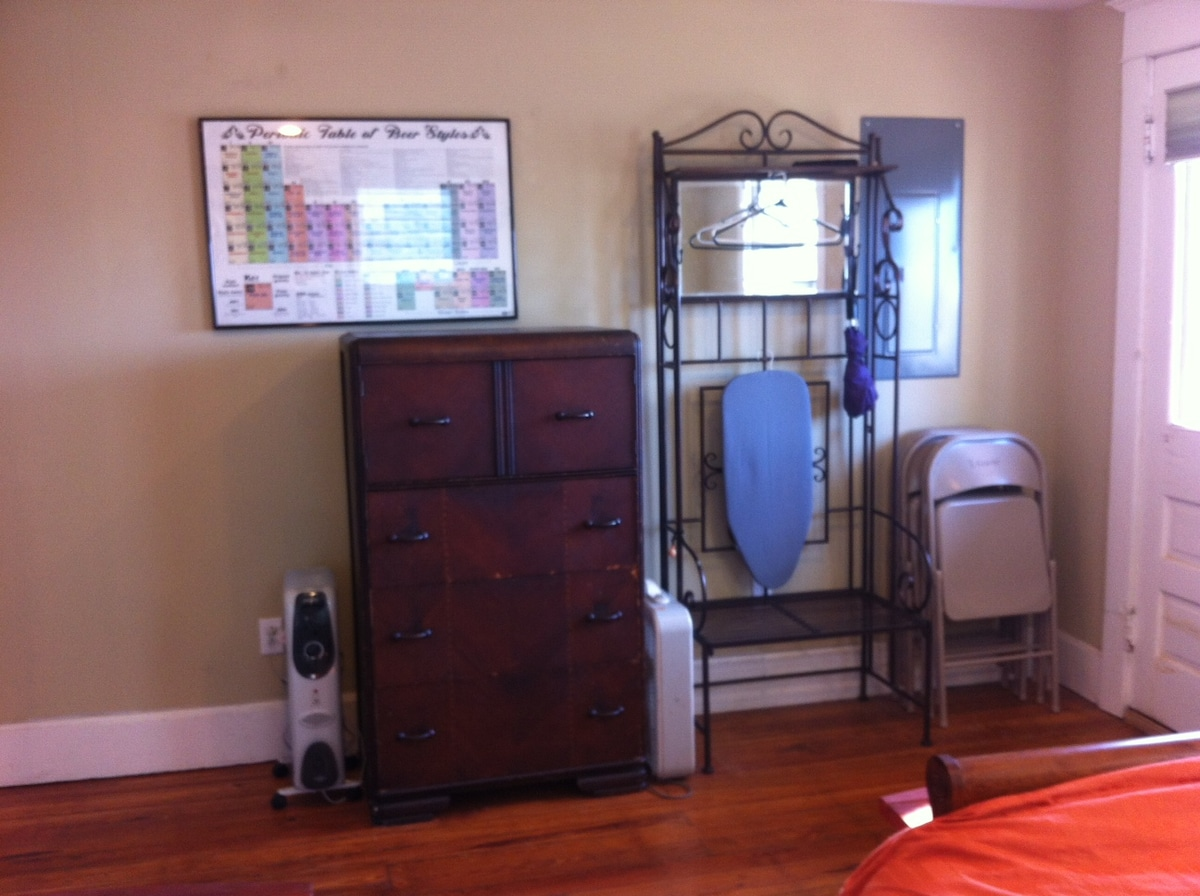 Dresser, ironing board, extra chairs, coat rack.