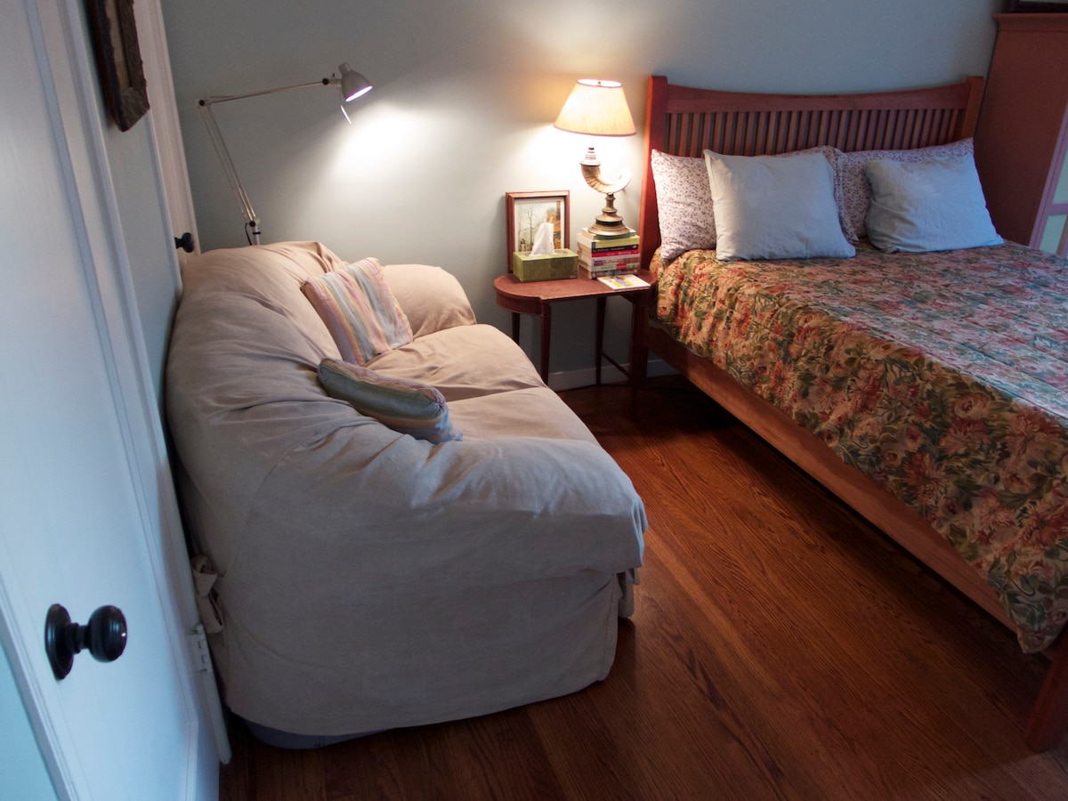Small, comfy sofa in master bedroom - you'll also have your own closet.