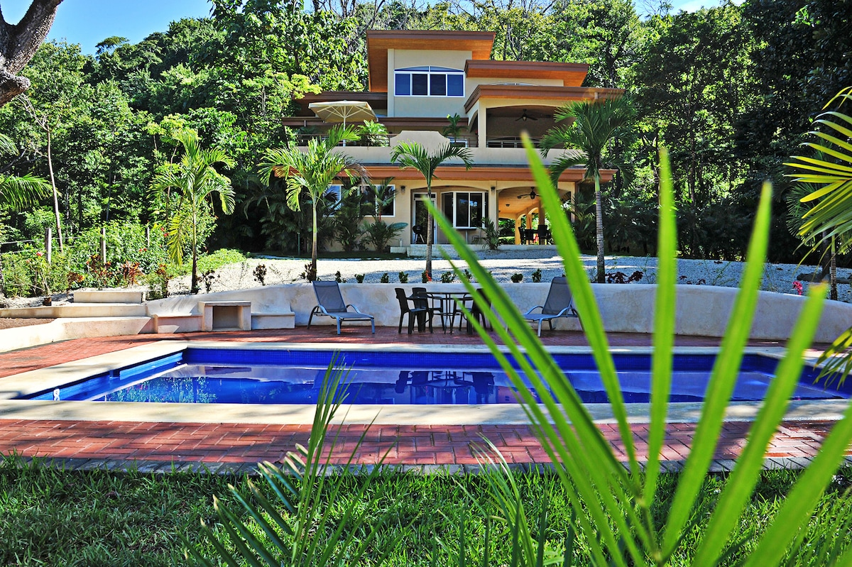 Our modern villa in a peaceful tropical  green space.