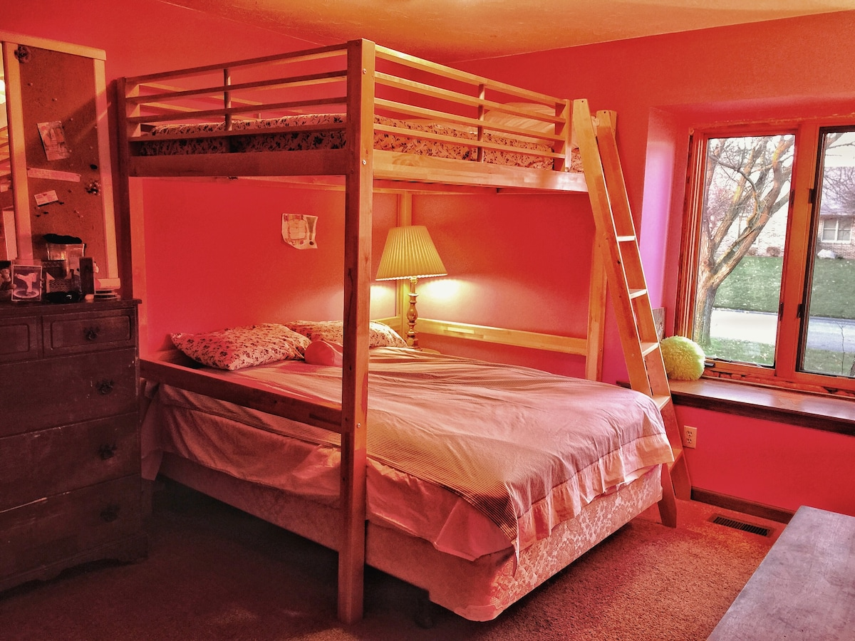 Kid's room with two full size beds (one on overhead loft with ladder access.  Recommended for agile adults and children).