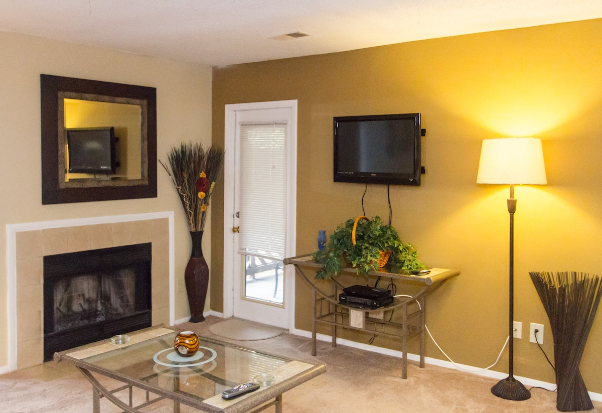 Living area spacious and well appointed with wood burning fireplace and access to patio.