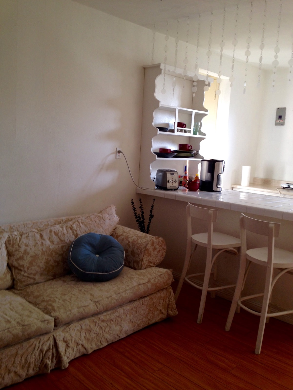 Full couch ~ Down Filled. Could be for extra person. Nice cooking area. & workspace,  too.