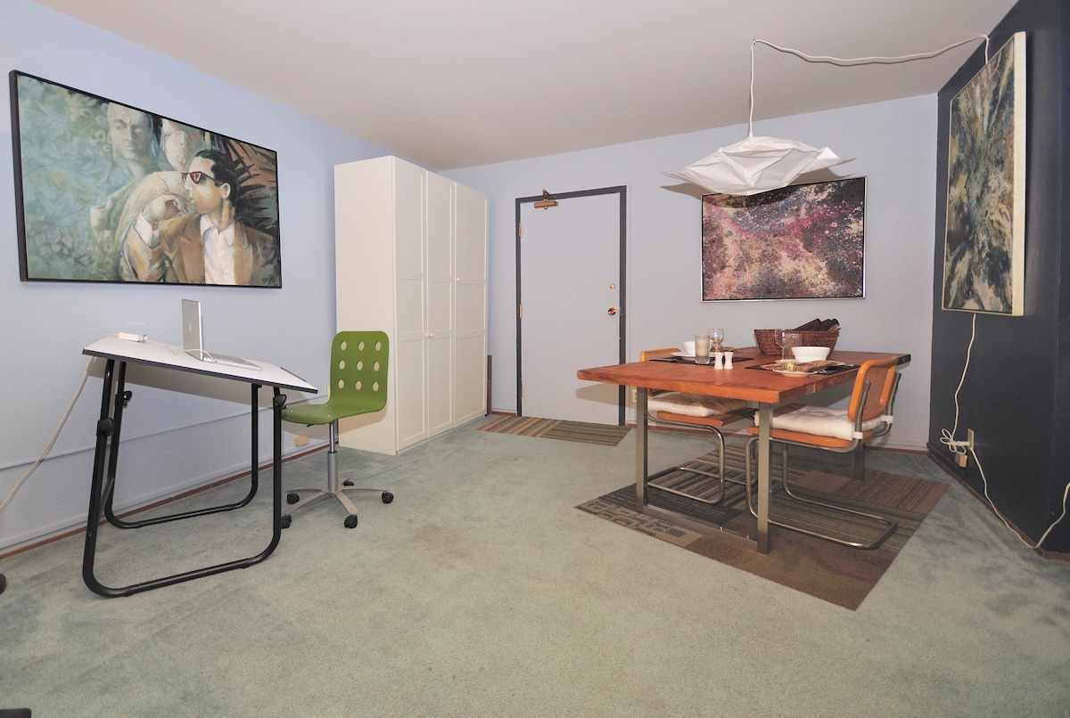 Use the drafting table for creative projects and enjoy dinner with full table settings.