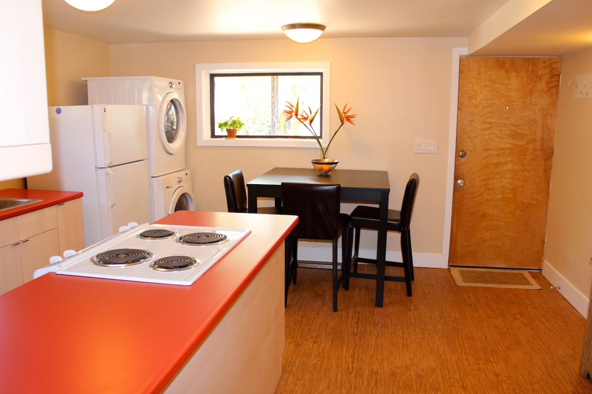 Newly remodeled kitchen with dining space and washer/ dryer