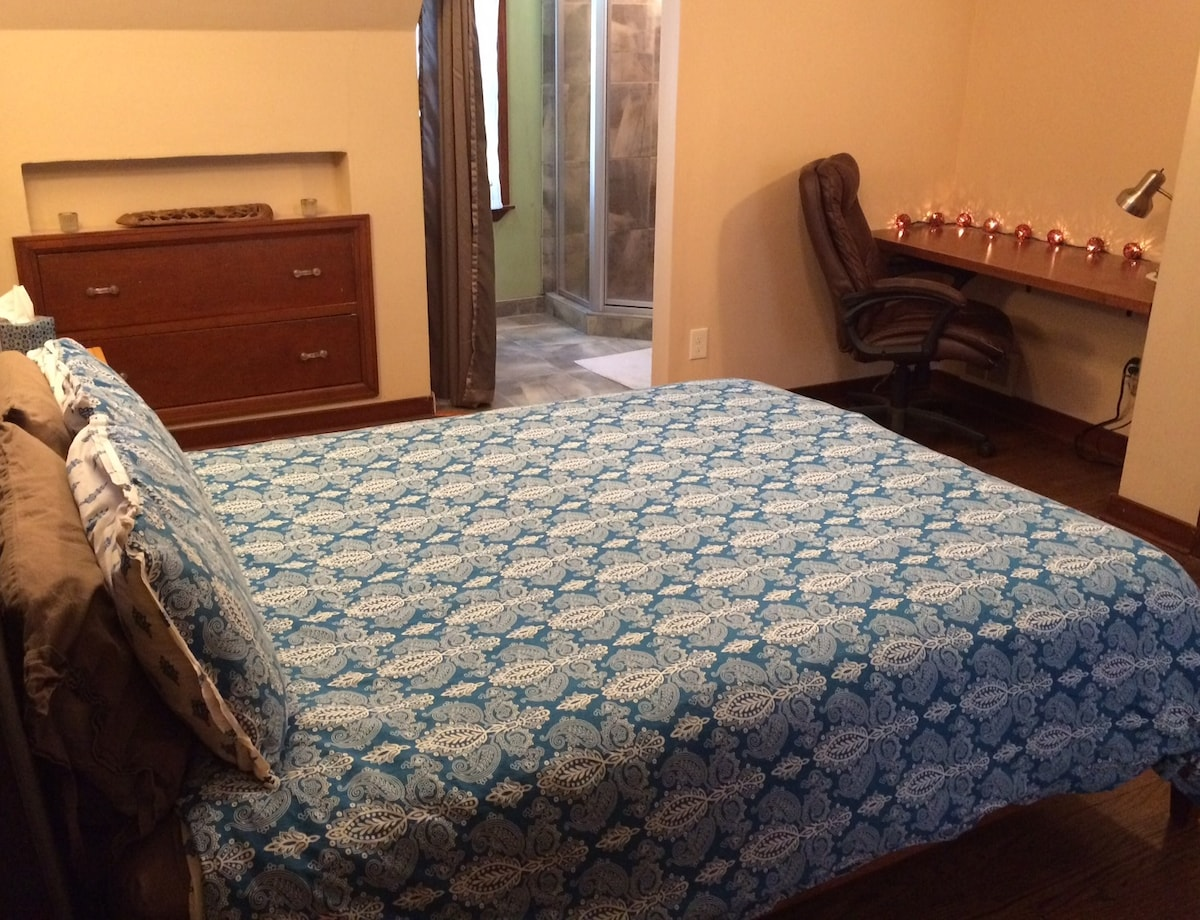 Here you can see the entire master suite, including the built-in workspace and master bath.  Please note, the bathroom has a privacy curtain, but no door.