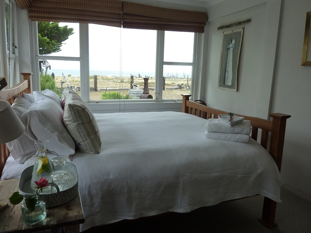Guests tell us the full size king bed is fabulously comfortable, with luxury goose down pillows & feather duvets (or allergy free). Sea & beach views from the bed. Sleep in. Enjoy our late checkout time! Towels, robes, luggage rack & home made body lotion