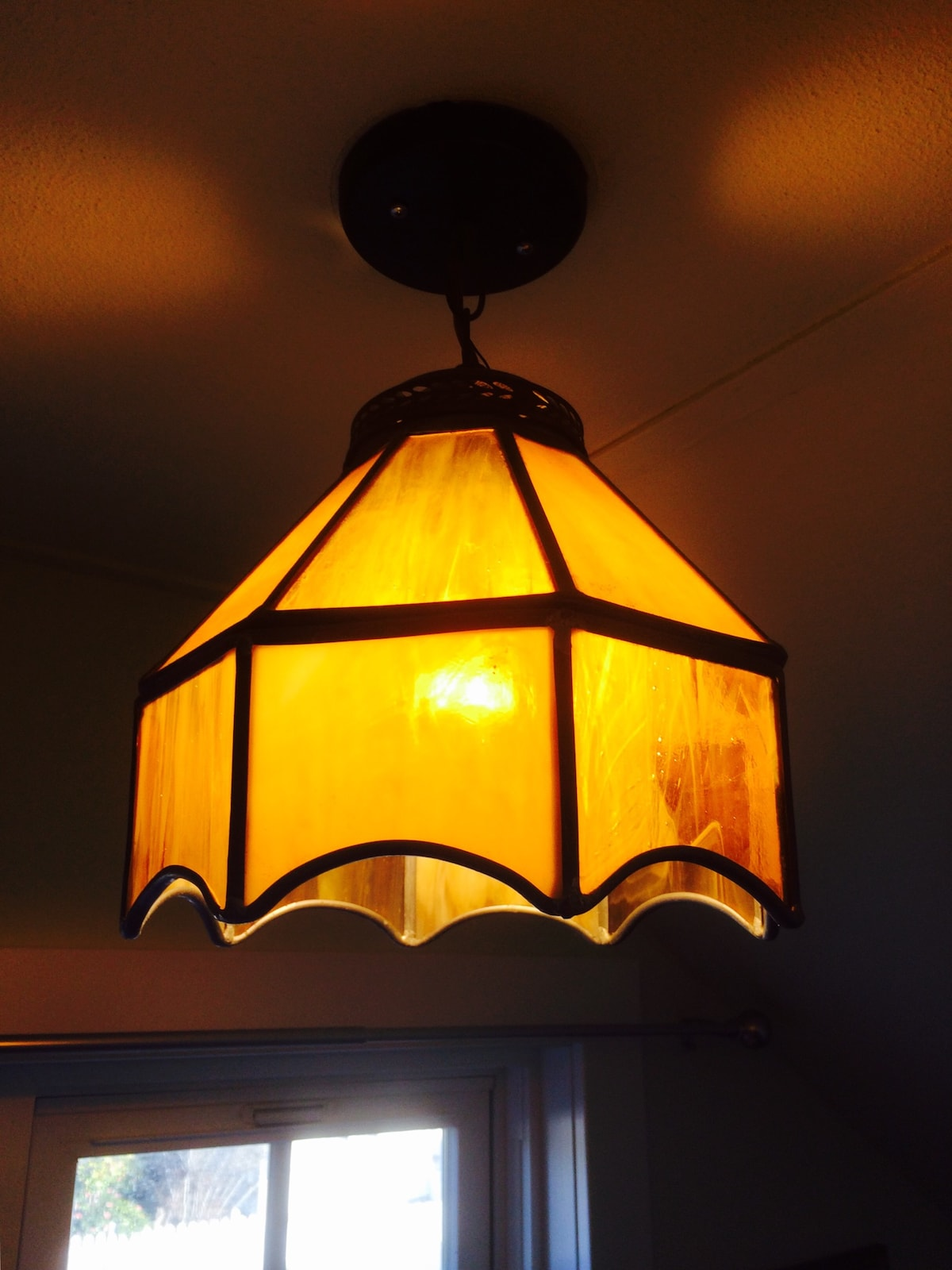 A Stained Glass lamp over the desk.