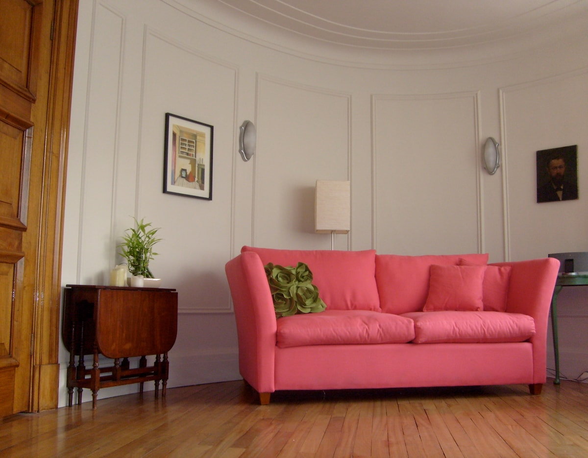 The Oval Office!   The living room is oval shaped, even the door is curved, carved mahogany... and one whole wall is windows