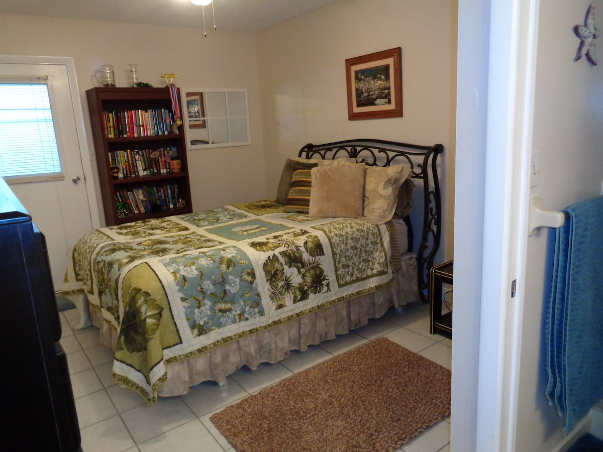 This is guest room 2. It is only for stays of 3 nights or more. The room has queen sized bed, private entrance to the outside and ensuite bathroom with vanity and large stall shower. It is $ 68 a night - or a lower weekly rate.