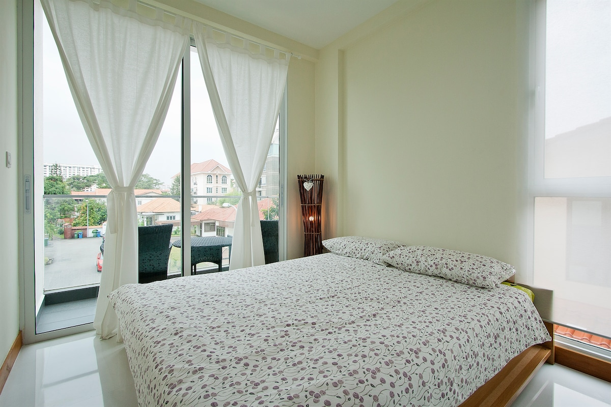 Master bedroom with attached bathroom, wardrobe and balcony