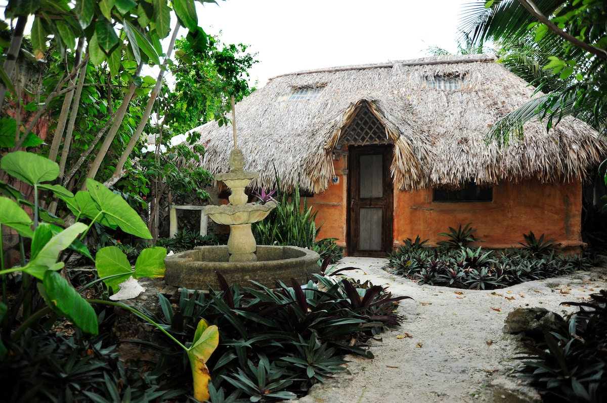 Casitas Kinsol Guesthouse in Puerto Morelos - near Cancun - Room #8 - A large authentic Mayan hut with a thatched roof -