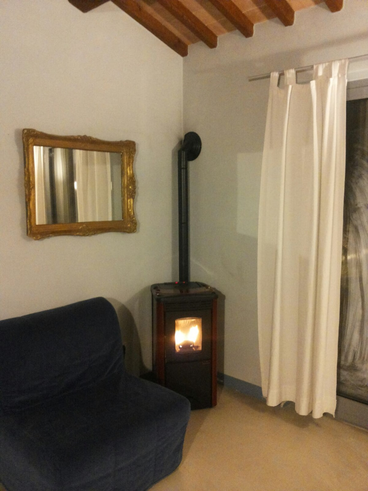 Relax in your cozy and comfortable sitting room and enjoy the fire of our automatic pellet stove
